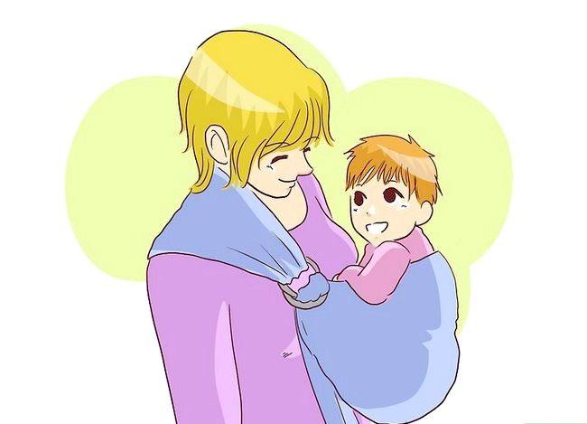 Prent getiteld Borsvoeding in `n Baby Carrier Stap 1