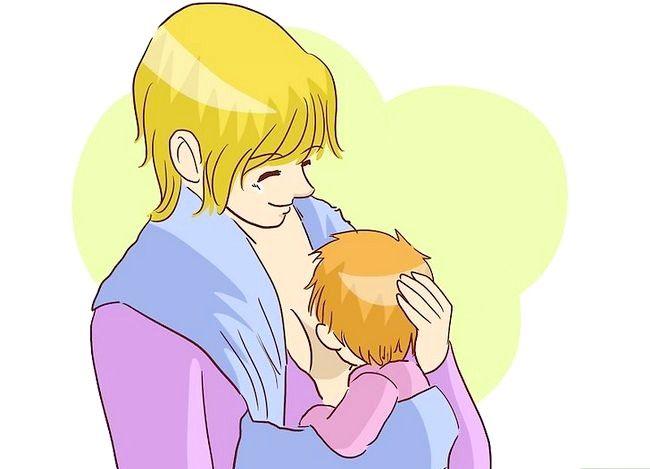 Prent getiteld Borsvoeding in `n Baby Carrier Stap 12