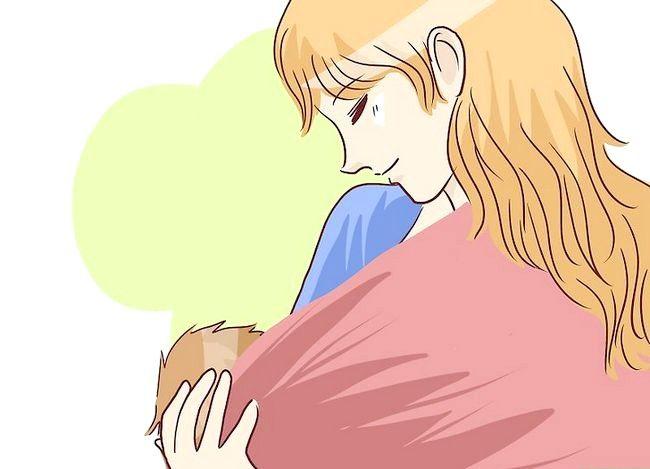 Prent getiteld Borsvoeding in `n Baby Carrier Stap 6