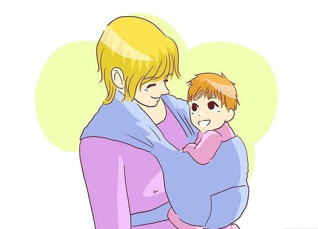 Prent getiteld Borsvoeding in `n Baby Carrier Stap 7