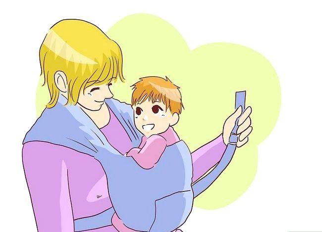 Prent getiteld Borsvoeding in `n Baby Carrier Stap 8