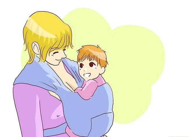 Prent getiteld Borsvoeding in `n Baby Carrier Stap 9