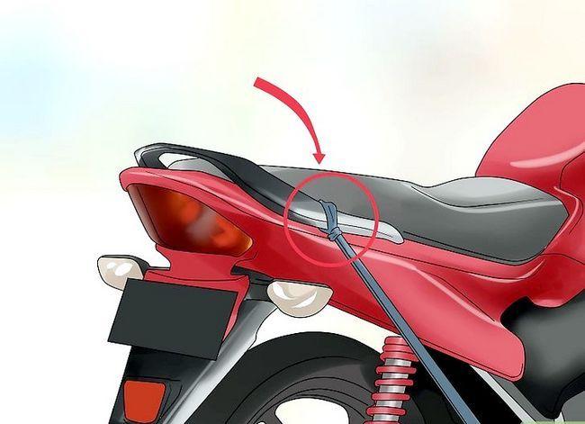 Prent getiteld Tie Down a Motorcycle Stap 9