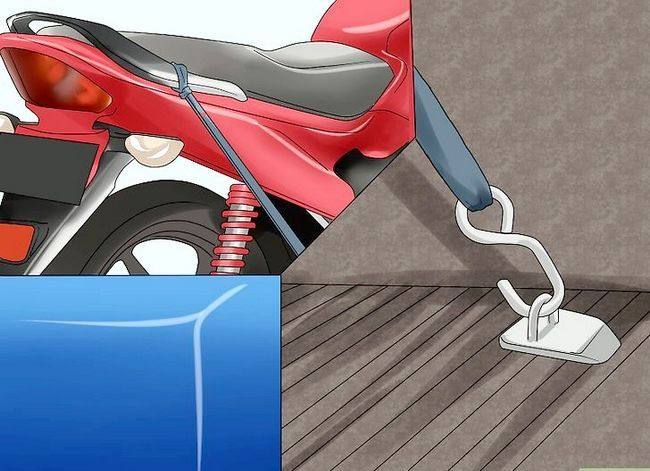 Prent getiteld Tie Down a Motorcycle Step 10