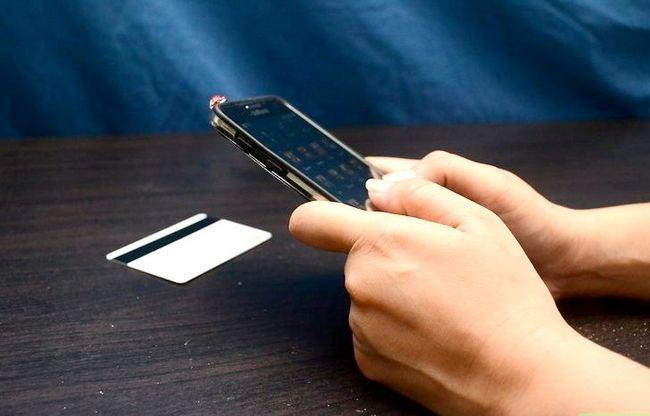 Beeld getiteld Kredietkaarte aanvaar per telefoon Stap 7