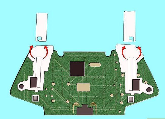 Prent getiteld Ontkoppel `n draadloze Xbox 360-kontroleerder vir die skildery van stap 16