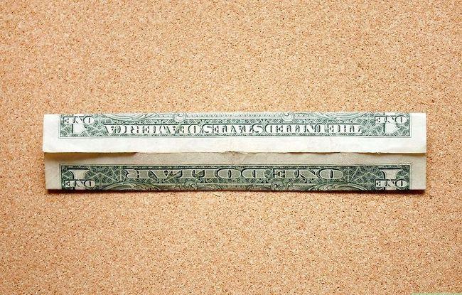 Prentjie getiteld Fold a Dime in `n Dollar Bill Stap 2