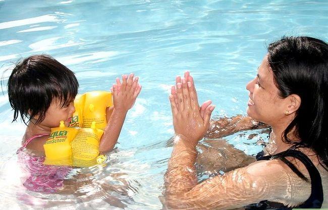 Prent getiteld Leer jou kind om Stap 2 te swem