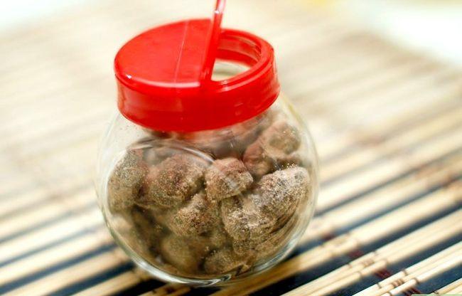 Prent getiteld Maak Chocolate Coated Almonds Stap 7