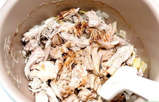 Prent getiteld Pulled Pork in die Crockpot Stap 5