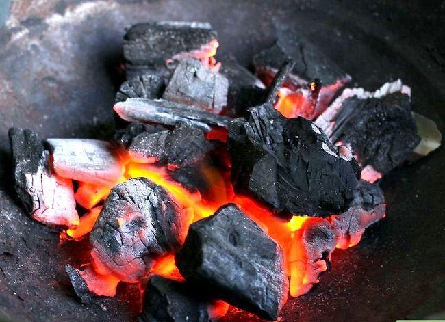 Prent getiteld Charcoal Grill Steaks Stap 1