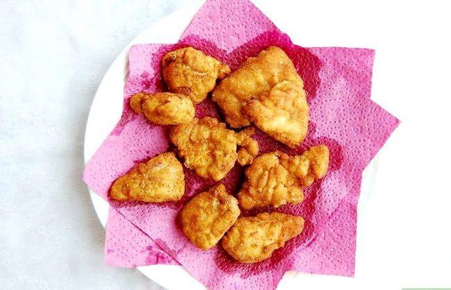 Prent getiteld Make Chicken Nuggets Stap 6