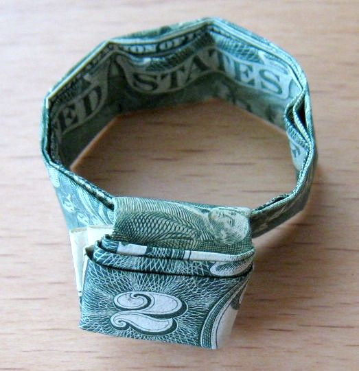 Prent getiteld Dollar_bill_ring14