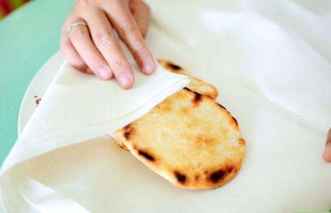 Prent getiteld Maak plat brood Stap 8