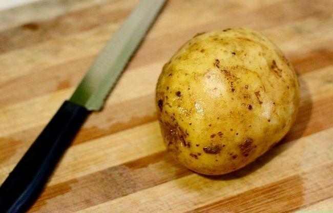 Prent getiteld Maak `n Gevulde Aartappel Met Chilli Con Carne Stap 1