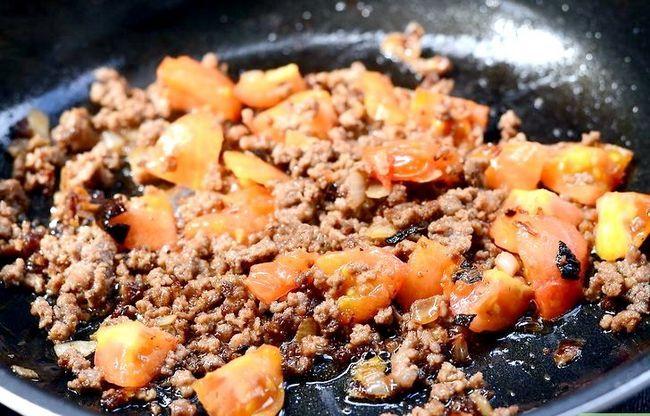 Prent getiteld Maak `n Gevulde Aartappel Met Chili Met Vleis Stap 5