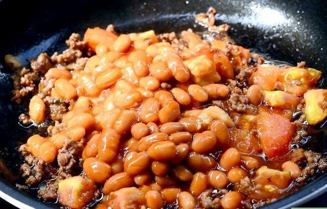 Prent getiteld Maak `n Gevulde Aartappel Met Chilli Con Carne Stap 6