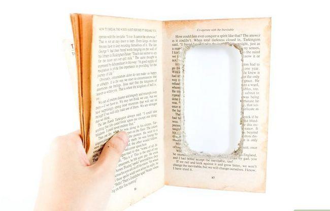 Prent getiteld Maak `n iPod-hoes uit `n boek Stap 7