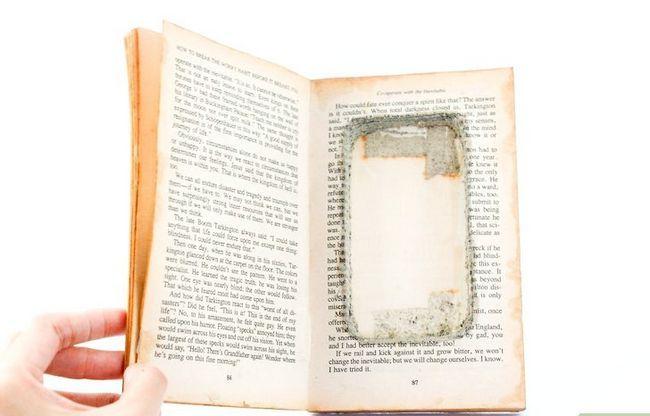 Prent getiteld Maak `n iPod-hoes uit `n boek Stap 9