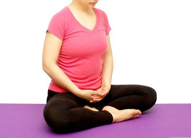 Prent getiteld Doen Kundalini Joga en Meditasie Stap 4