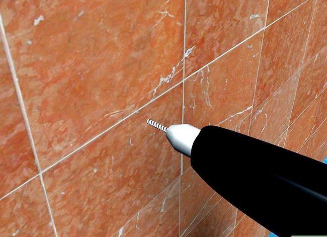 Beeld getiteld Installeer Badkamertoebehore op Keramiek Tile Stap 4