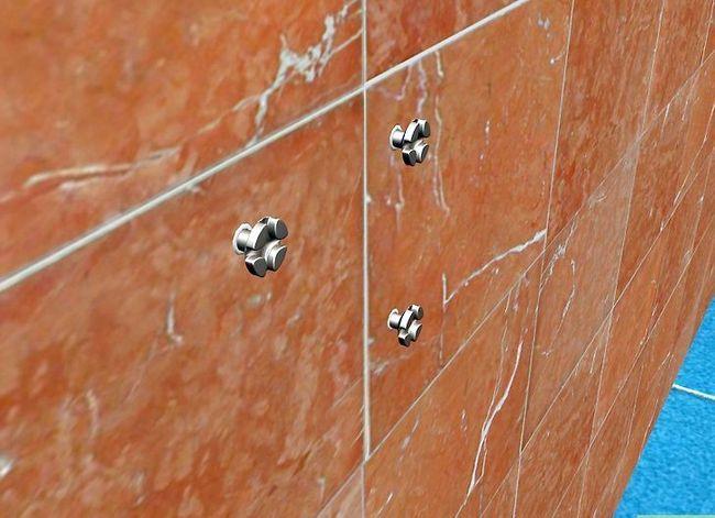 Beeld getiteld Installeer Badkamertoebehore op Keramiek Tile Stap 7