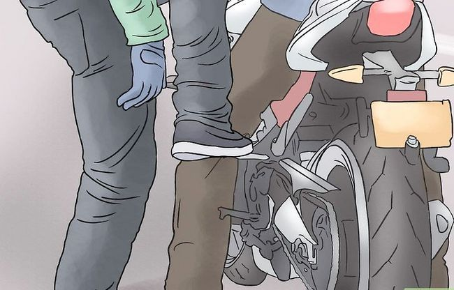 Prent getiteld Ry op die rug van `n motorfiets Stap 11