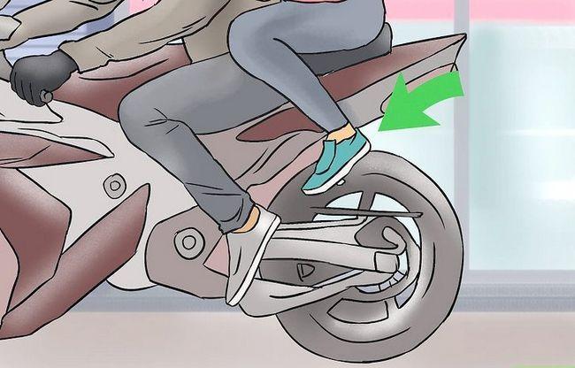 Beeld getiteld Ry op die rug van `n motorfiets Stap 16