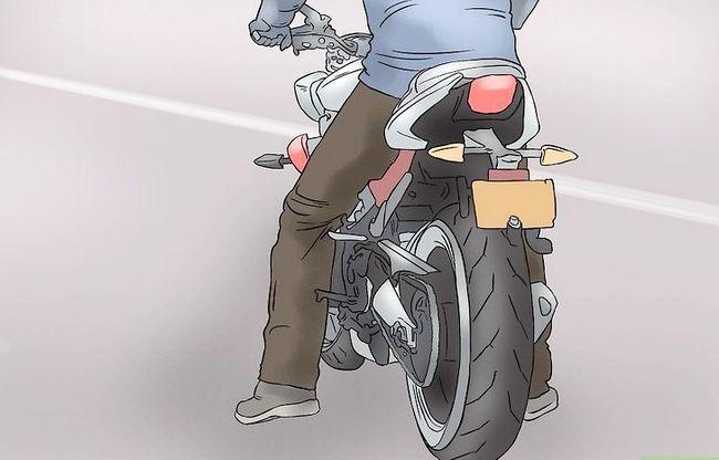Prent getiteld Ry op die rug van `n motorfiets Stap 9