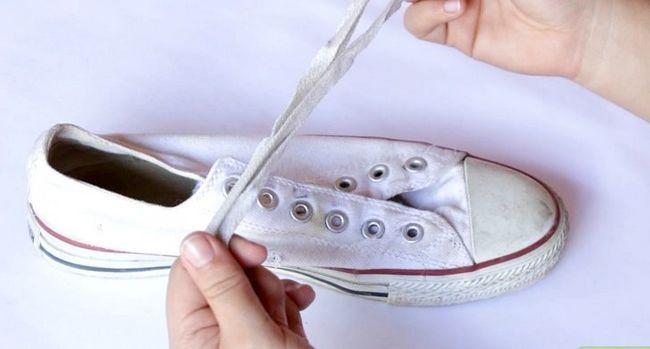 Prent getiteld Was skoene Stap 1