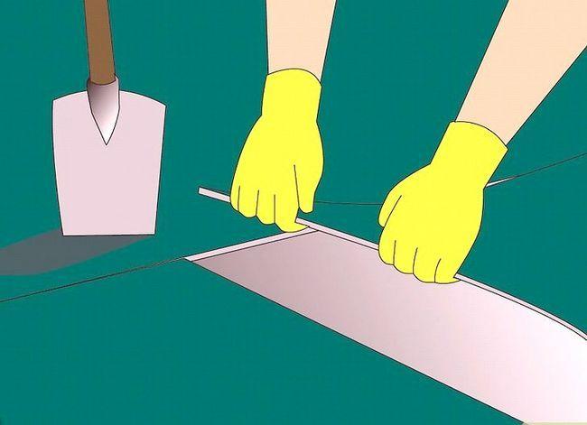 Prent getiteld Verwyder Latex Rubber Tapyt en Tile Plak van `n Sementvloer Stap 4