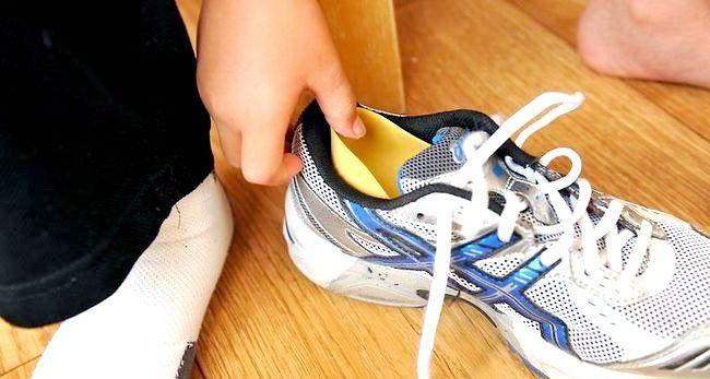 Prent getiteld Dra grootmaat skoene Stap 4