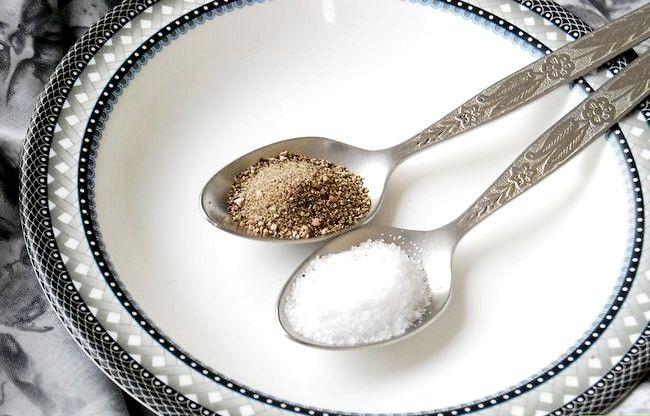 Prent getiteld Neem 2 Tafelslepels Sout en Peper Stap 1