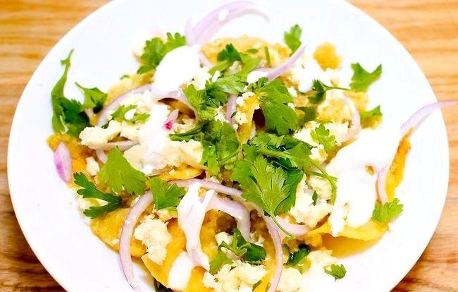 Prent getiteld Berei Meksikaanse Chilaquiles Stap 21 voor