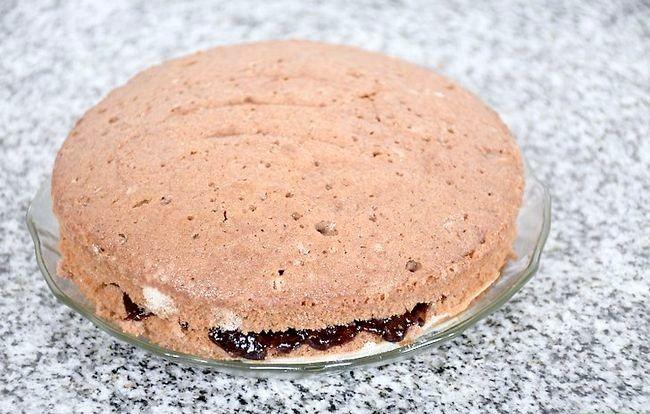 Prent getiteld Maak `n Belgiese Sjokolade Layer Cake Finale