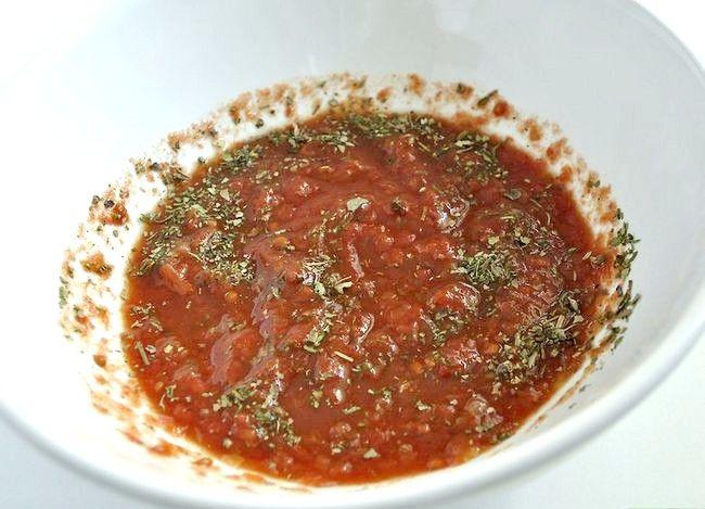 Prent getiteld Maak Kip Spicy Garlic Pizza Stap 13