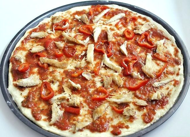 Prent getiteld Maak Kip Pittige Knoffel Pizza Stap 16