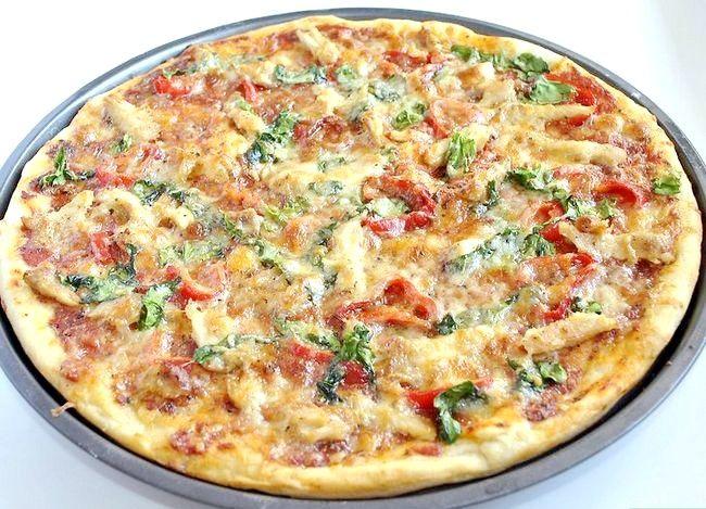Prent getiteld Maak Kip Spicy Garlic Pizza Stap 19