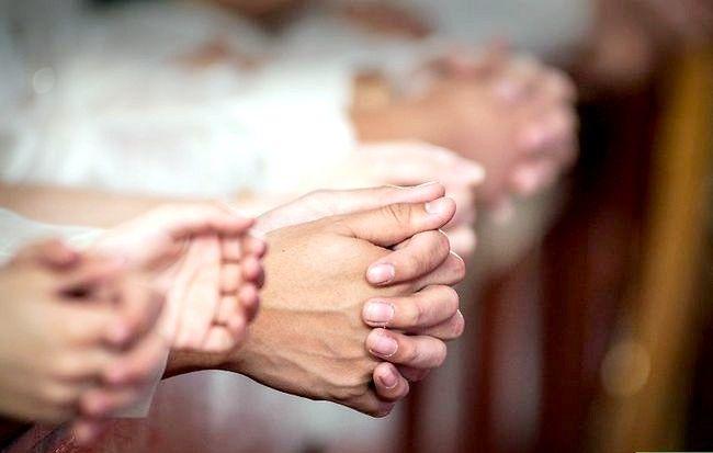 Prent getiteld Neem Nagmaal in die Katolieke Kerk Stap 9