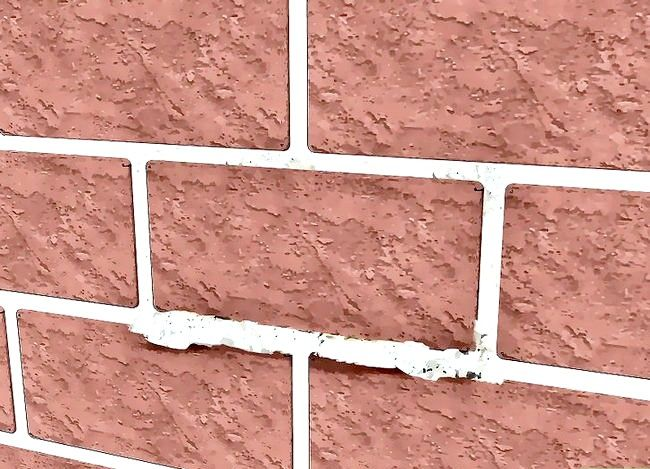 Prent getiteld Vervang `n beskadigde baksteen Stap 12
