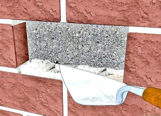 Prent getiteld Vervang `n beskadigde baksteen Stap 10