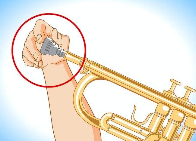 Hoe om `n stewige mondstuk op `n wind instrument te verwyder