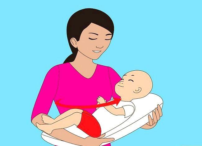 Prent getiteld Gebruik verskillende borsvoedingsposisies Stap 11