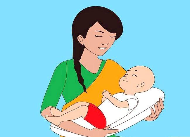 Prent getiteld Gebruik verskillende borsvoedingsposisies Stap 2