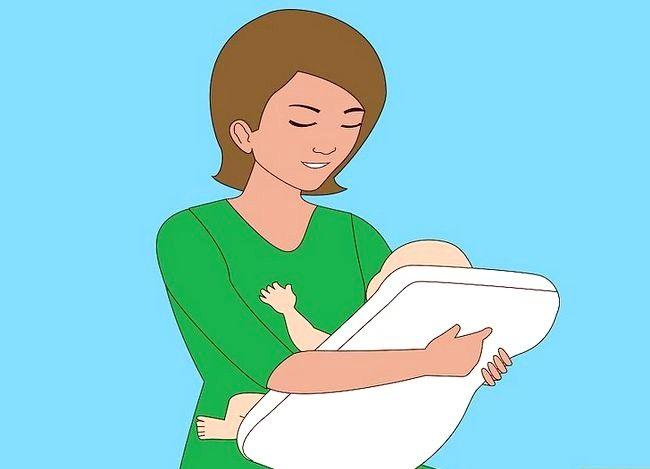 Prent getiteld Gebruik verskillende borsvoedingsposisies Stap 3