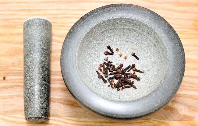 Prent getiteld Gebruik `n mortier en stamper Stap 4